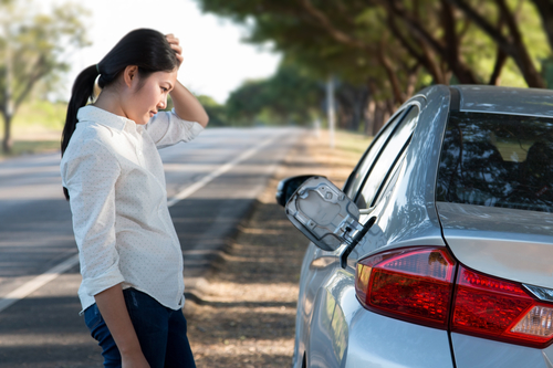 Car oil down and Young woman confusing.
