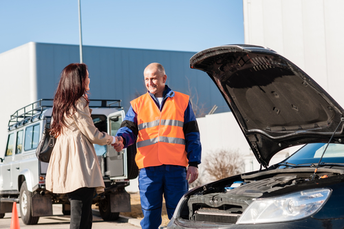 Woman shaking hands with mechanic car breakdown crash accident man